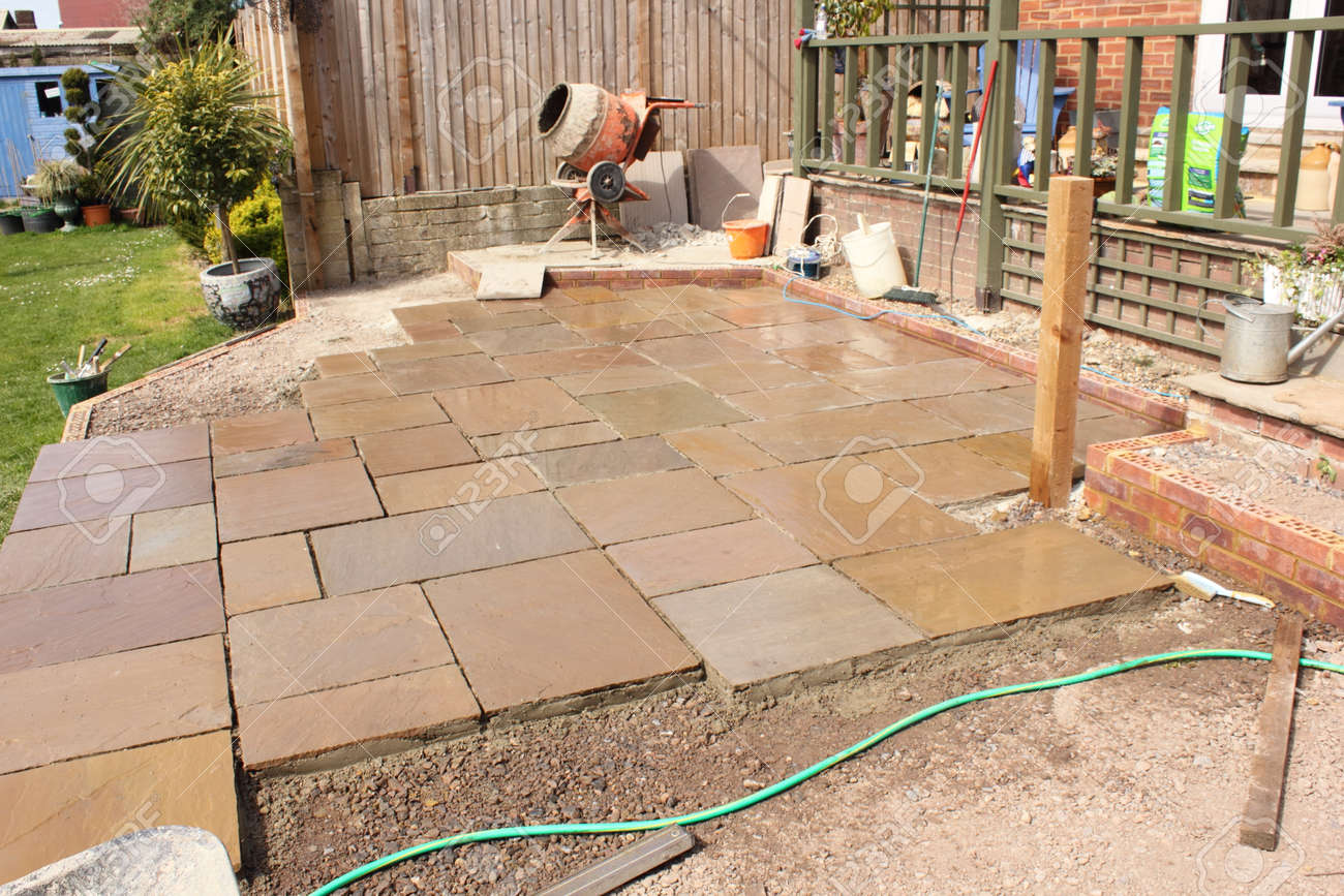 the construction and building of a natural stone patio in an