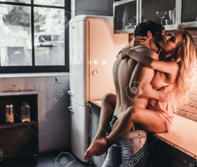 Attractive Passionate Couple Is Having Sex On Kitchen Stock Photo 83407404