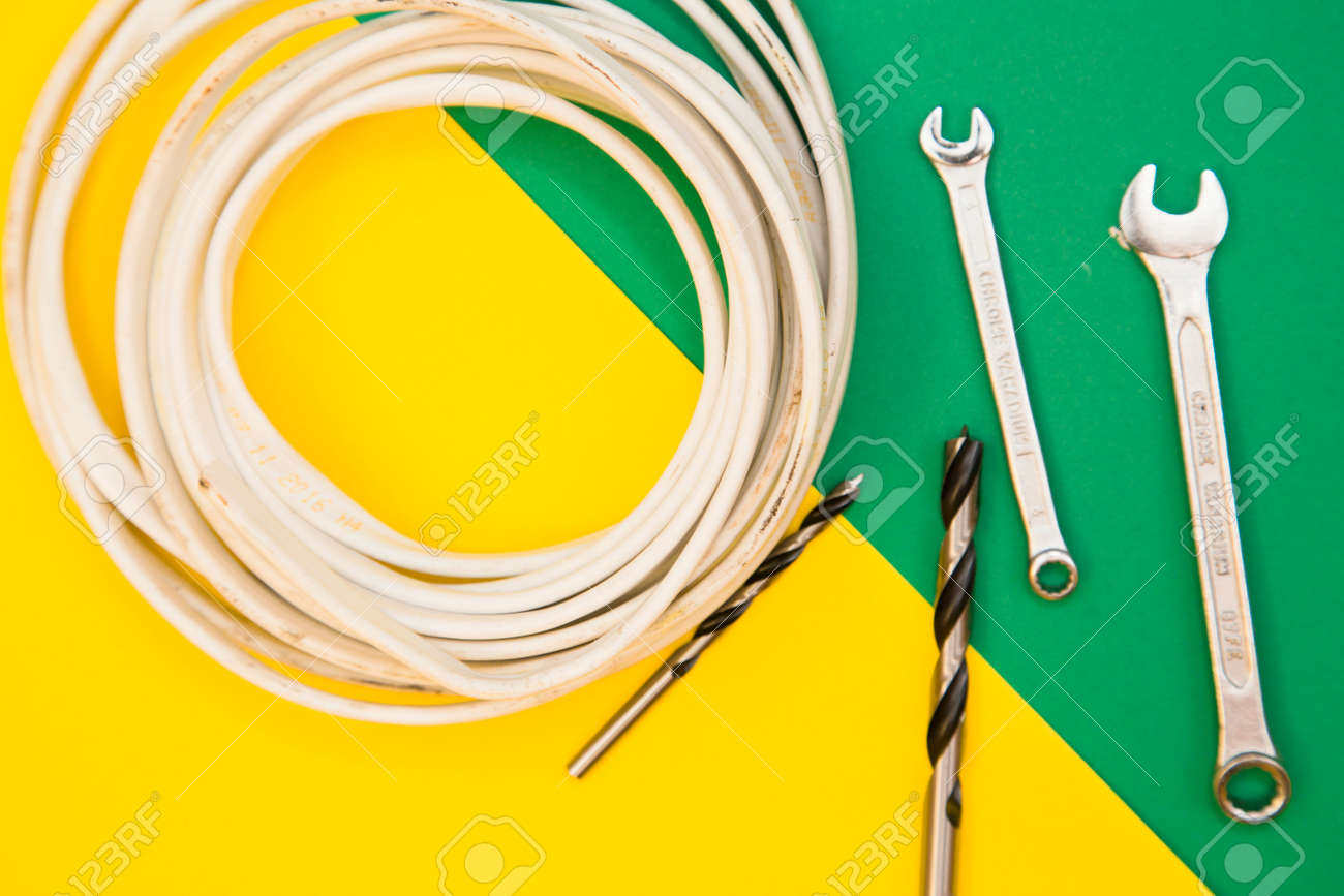 hight resolution of home house repair concept a skein of white cable twist drill bits and