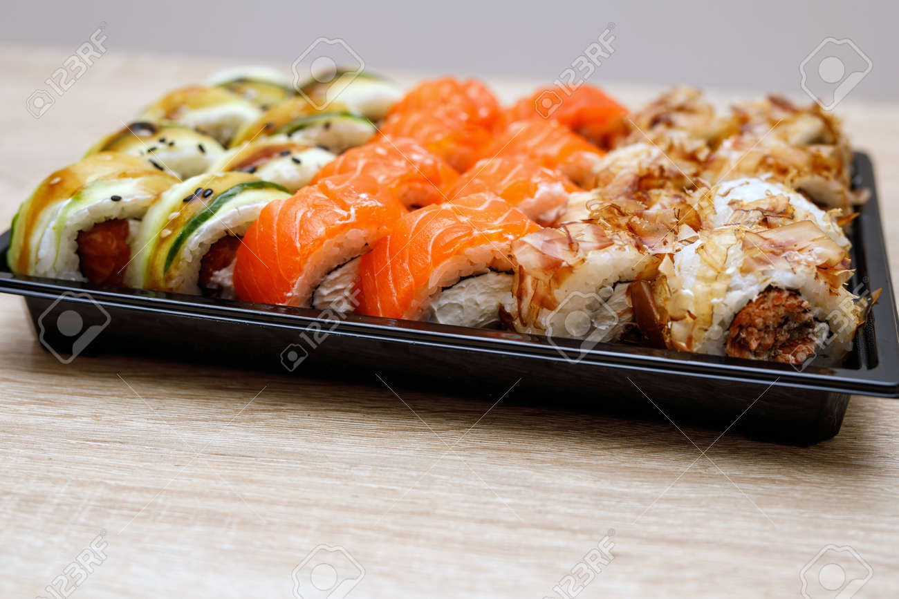 https www 123rf com photo 143280077 delivery service sushi rolls in plastic box html