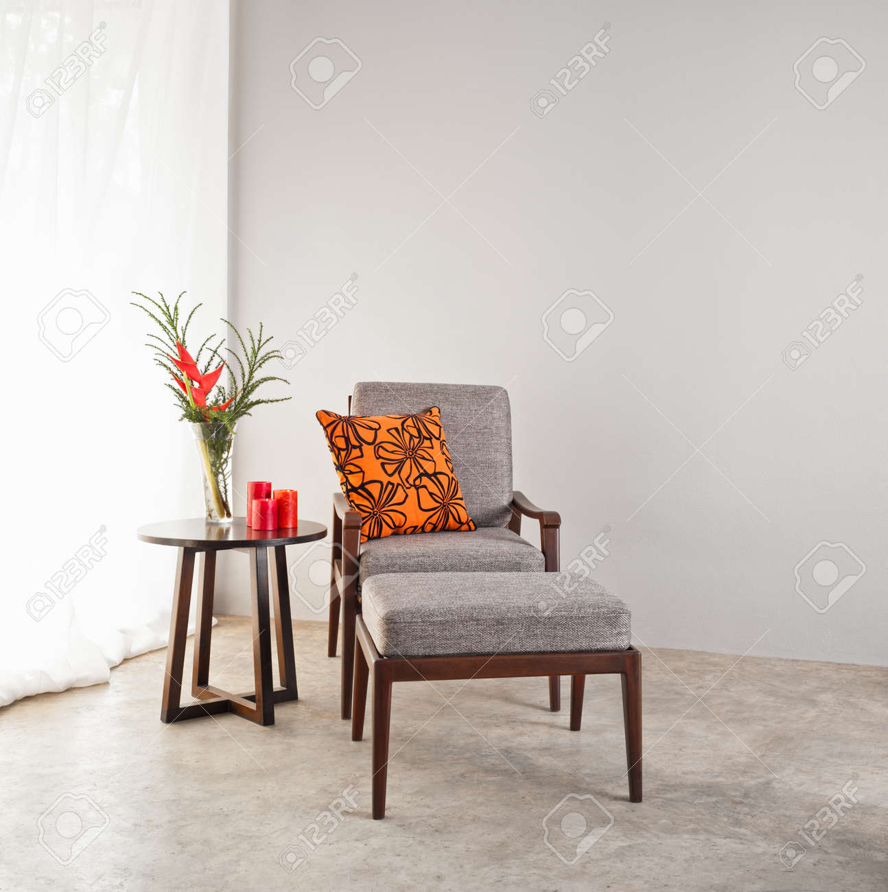 orange upholstered chair advantage church chairs grey with footstool and pillow stock photo 25837507