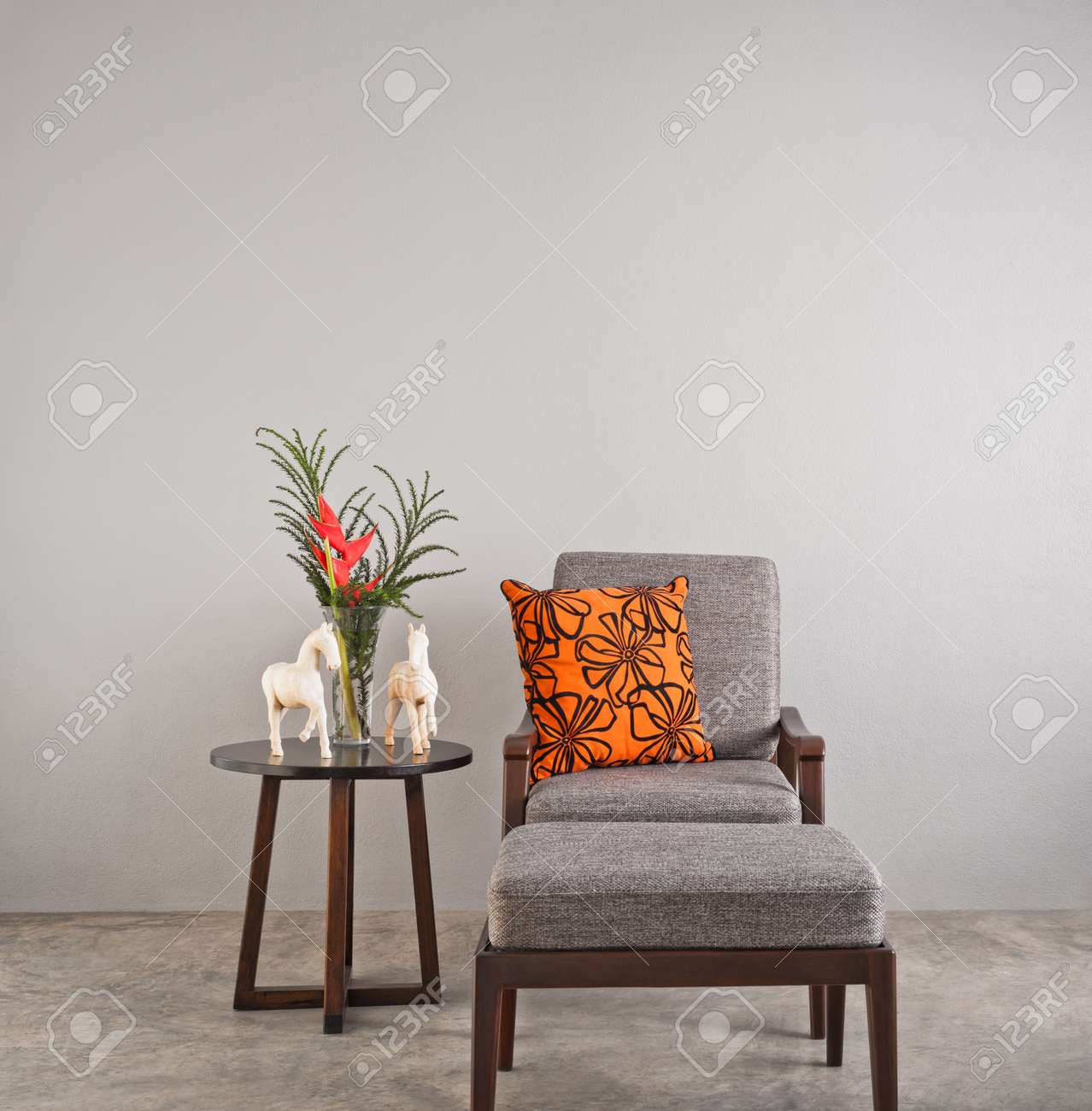orange upholstered chair led table and chairs grey with footstool pillow stock photo 25837512