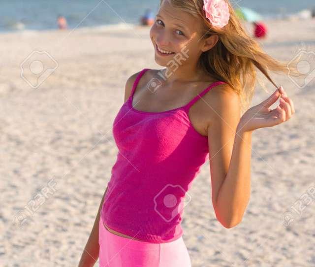 Portrait Of A Cheerful Teen Girl On The Beach Stock Photo 15688093