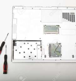 back side of a modern laptop computer without battery lying on a white background viewed from [ 1300 x 866 Pixel ]