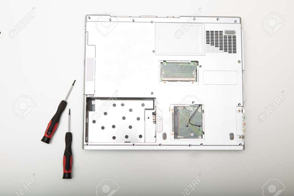 medium resolution of back side of a modern laptop computer without battery lying on a white background viewed from