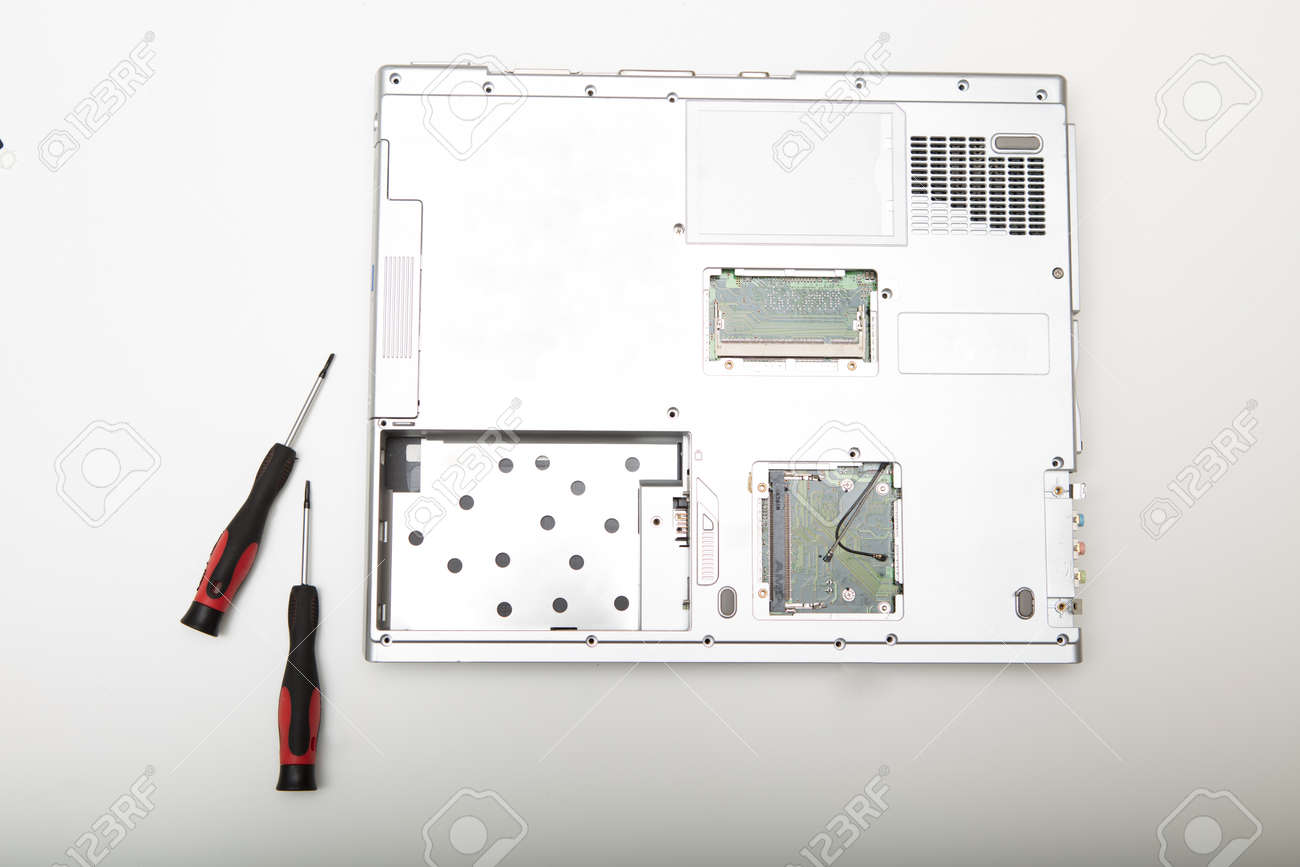 hight resolution of back side of a modern laptop computer without battery lying on a white background viewed from