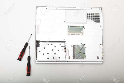 small resolution of back side of a modern laptop computer without battery lying on a white background viewed from