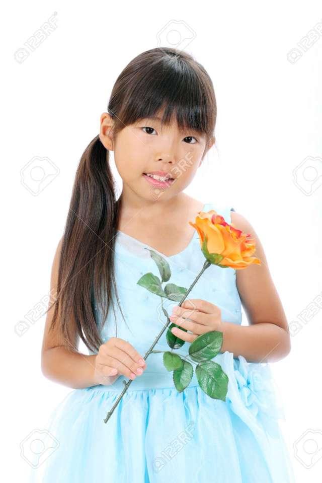 Photo Of Little Asian Girl Holding Rose Flower Stock Photo 16334298