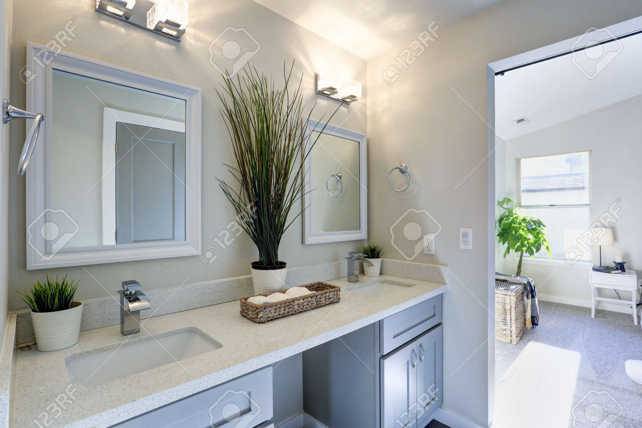 Warm And Clean Bathroom With Grey Double Vanity Cabinet Topped Stock Photo Picture And Royalty Free Image Image 93398681
