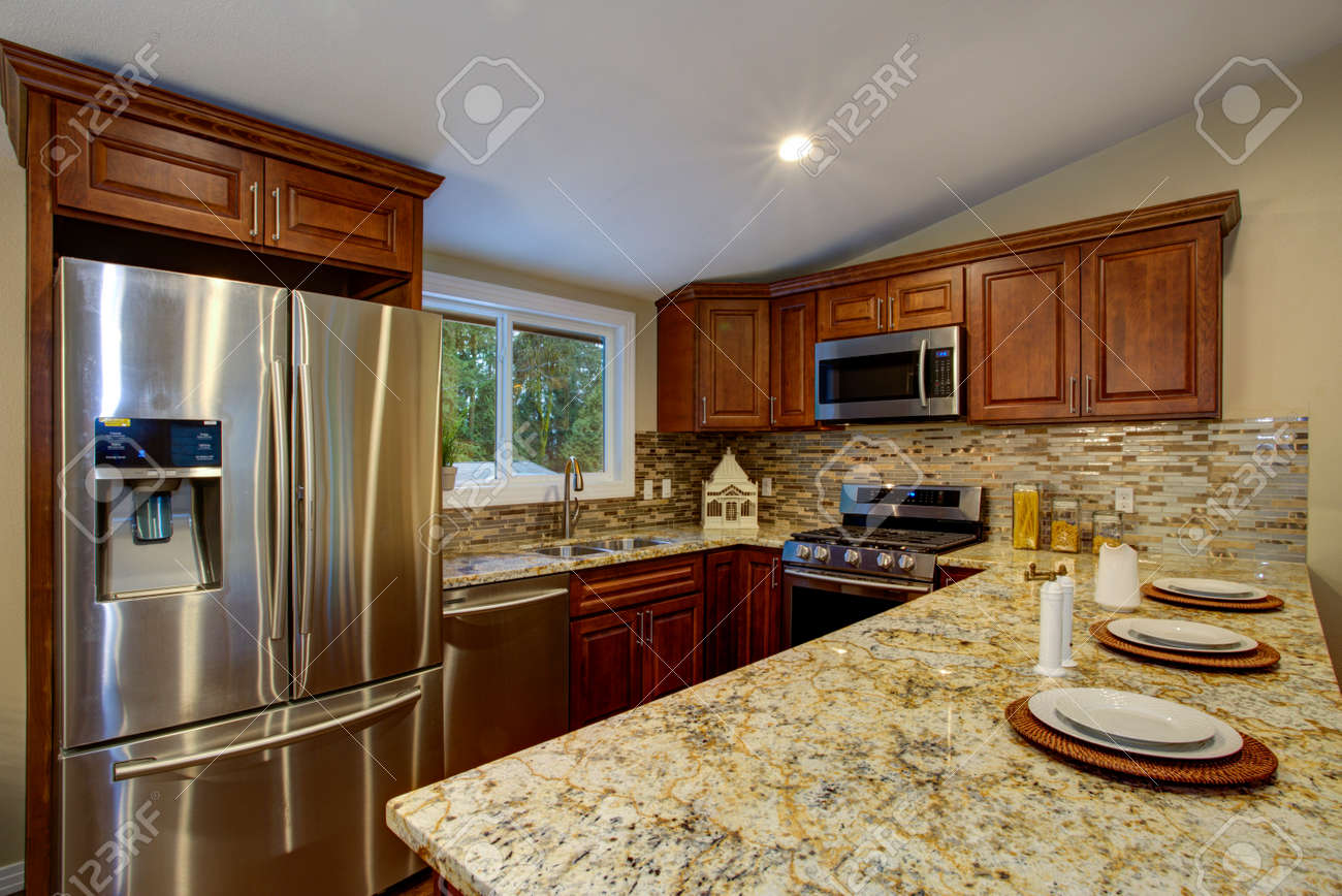 brown kitchen design with mahogany kitchen cabinets breakfast
