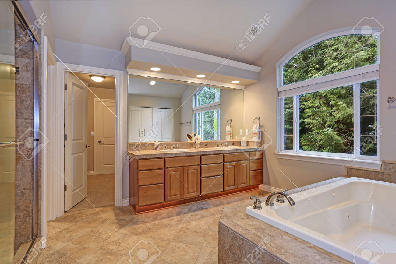 Stunning Master Bathroom With Double Vanity Cabinet Large Arched Stock Photo Picture And Royalty Free Image Image 96644431