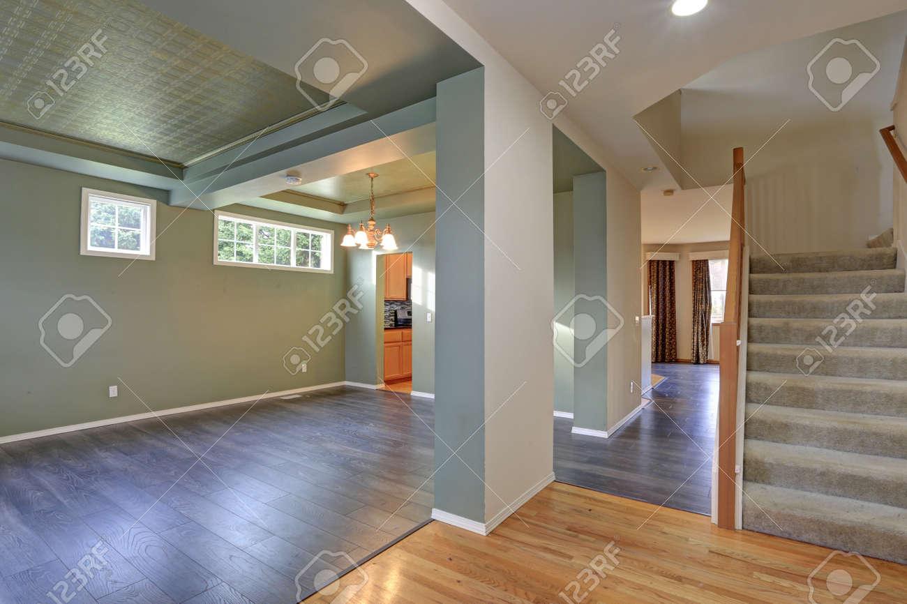 dark grey flooring living room wall shelf ideas spacious empty interior with hardwood floor green olive walls stock