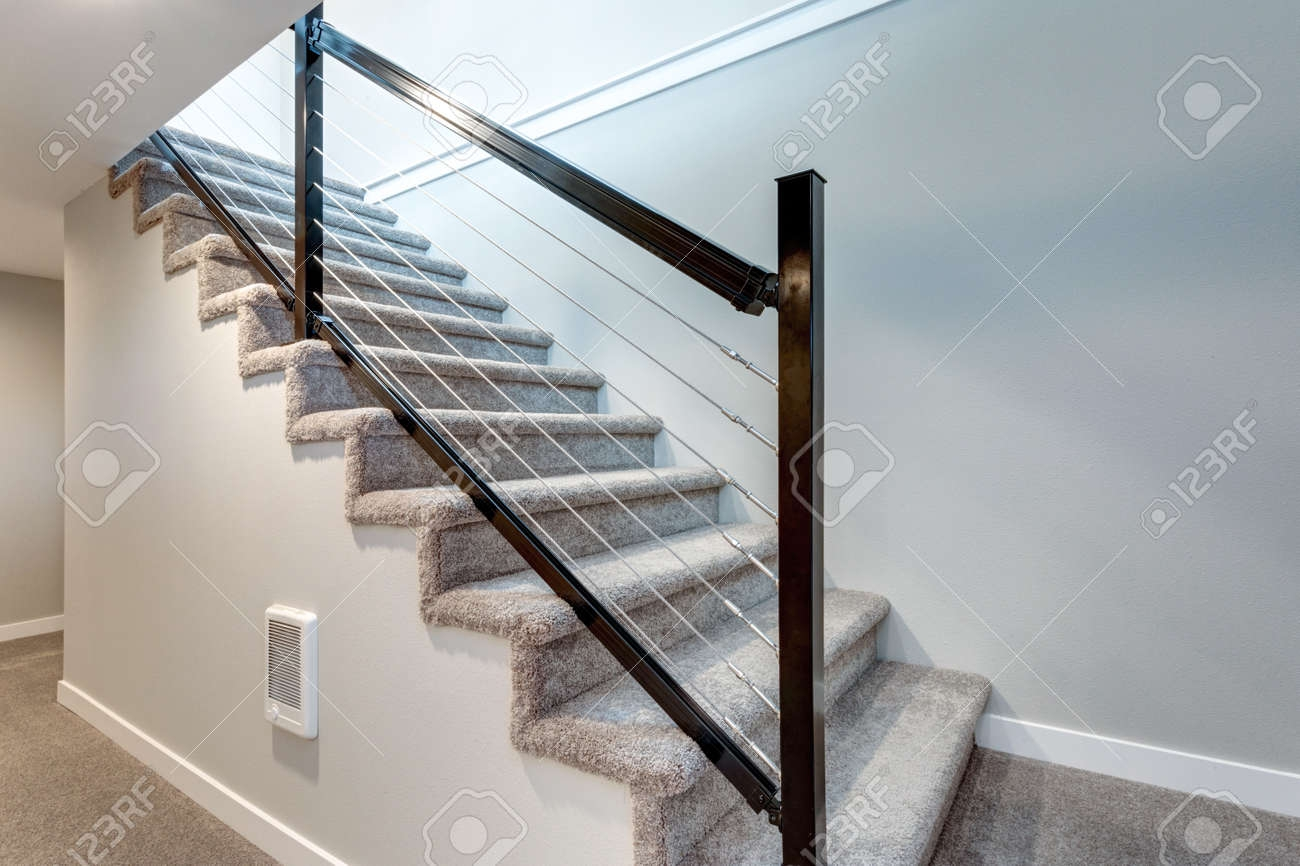 Close Up View Of A Staircase With Black Metal Railings Stock   Black Metal Railing For Stairs   Rail   Double Basket   Kid Safe   Residential   Modern