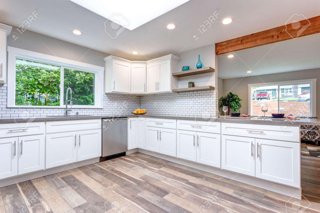 Open Concept Kitchen With White Cabinets Grey Quartz Countertops Stock Photo Picture And Royalty Free Image Image 104976948