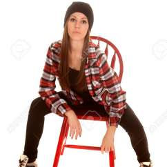 Desk Chair Leans Forward Antique Barber Chairs For Sale A Woman Sitting In Leaning With Her Plaid Shirt And Serious Expression