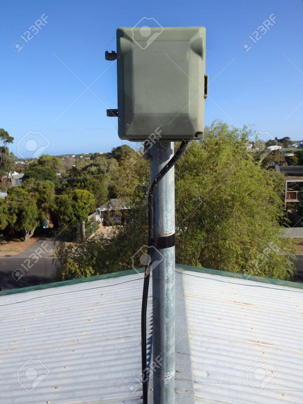 hight resolution of plastic electrical box receptor outdoor on a pole on top of a roo stock photo