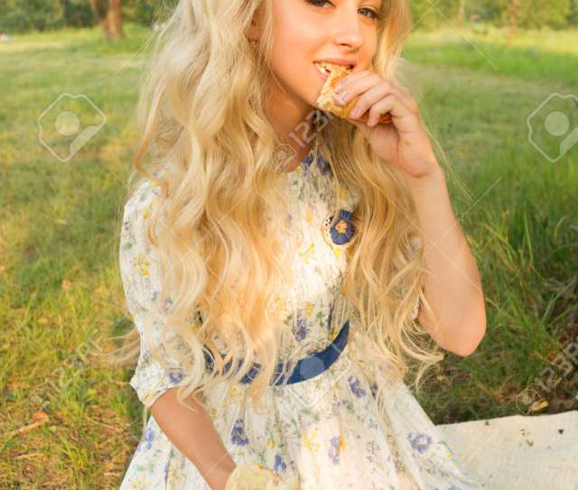 Beautiful Charming Long Curly Blonde Hair Teenage Girl Wearing A Long Light Dress Outdoors On A