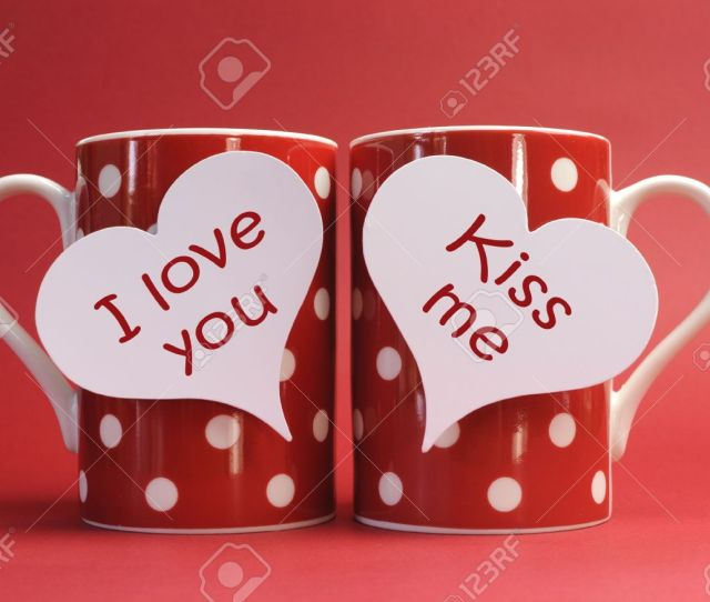 I Love You And Kiss Me Messages On Red Polka Dot Mugs Against A Red Background