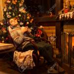 Young Man Relax In Rocking Chair At Home Near Fireplace