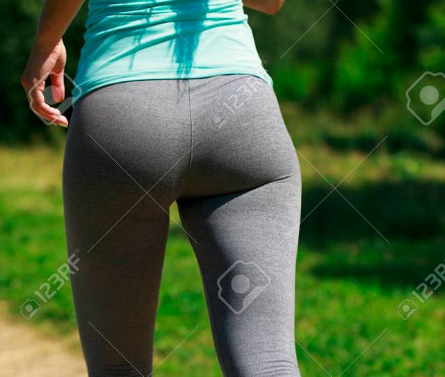 Close Up Sexy Ass Athletic Woman Working Out In A Meadow From A Complete