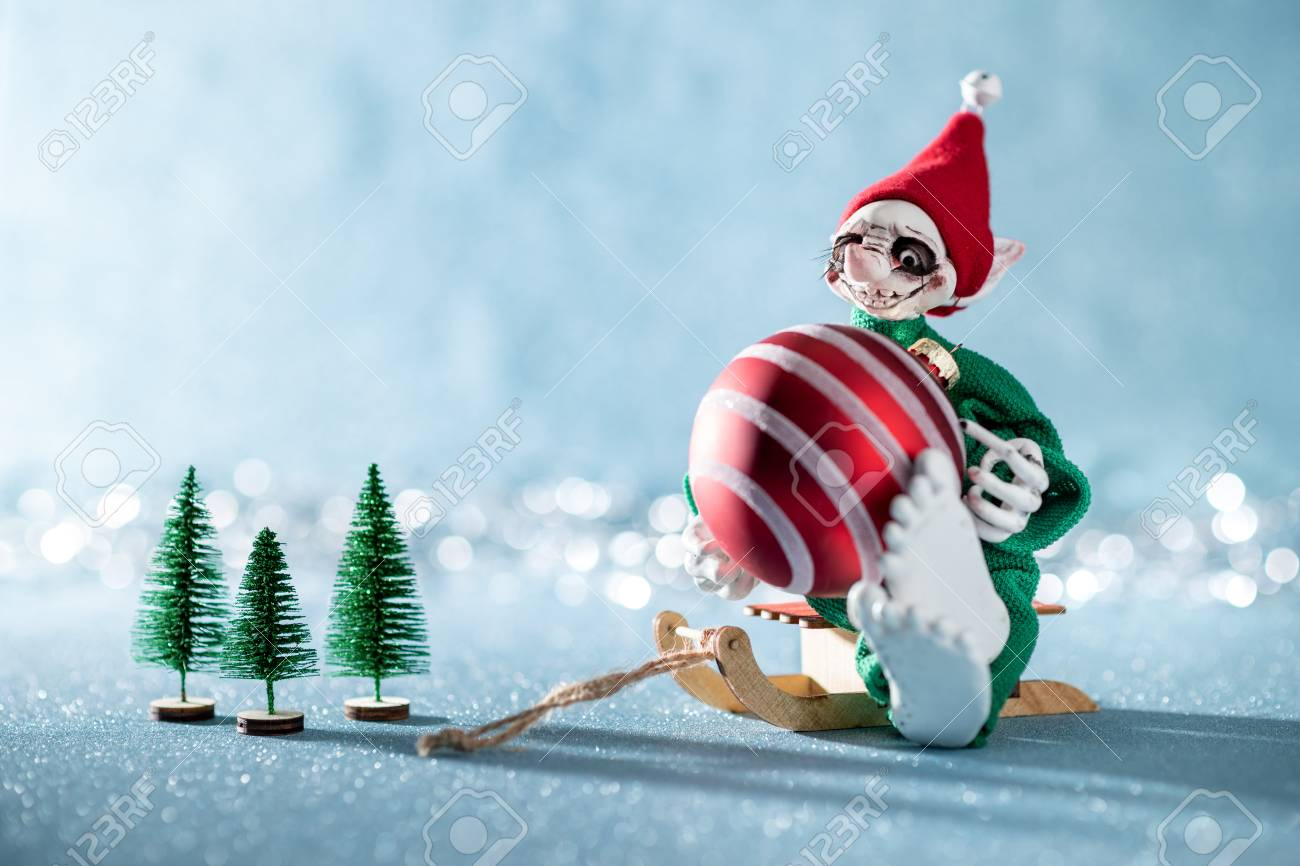 Cute Cheerful Santas Helper Elf Sitting On Santas Sleigh With Stock Photo Picture And Royalty Free Image Image 110792749