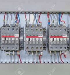 several electrical contactor on a mounting panel in electrical closet modern contactors to start motors [ 1300 x 866 Pixel ]