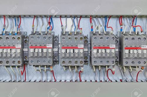 small resolution of several electrical contactor on a mounting panel in electrical closet modern contactors to start motors