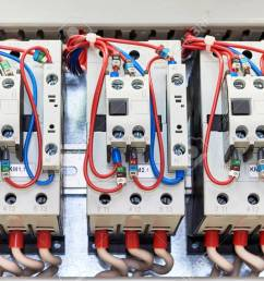 several contactors arranged in a row in an electrical closet the contactors connected wire number [ 1300 x 866 Pixel ]