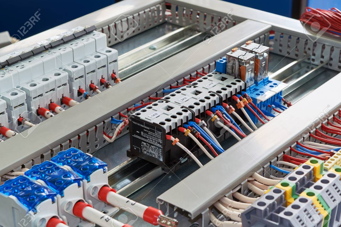 hight resolution of contactors relays circuit breakers and terminals in the electrical cabinet electrical wires or