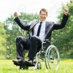Wheelchair Man Ideas For Old Wooden Folding Chairs Happy Young Disabled On With Raised Arms In Park Stock Photo 61417027