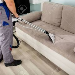 Sofa Cleaner 2 Seater Chaiselong Rear View Of Young Male Worker Cleaning With Vacuum Stock Photo 69329780