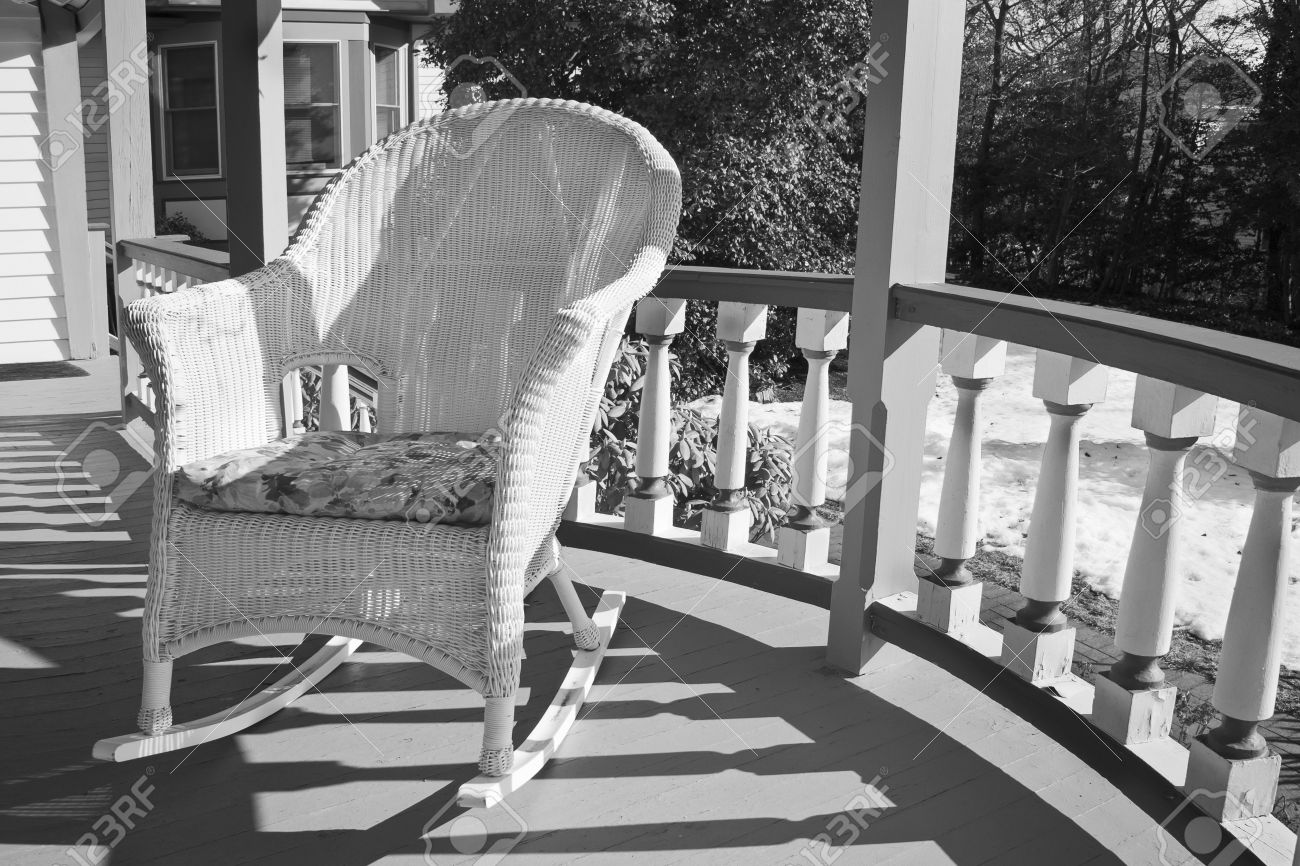 Black Wicker Rocking Chairs A Wicker Rocking Chair On A Porch In Black And White