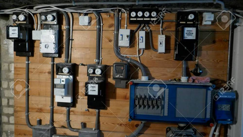 medium resolution of electrical fuse boxes and power lines in the basement of an old apartment building stock photo