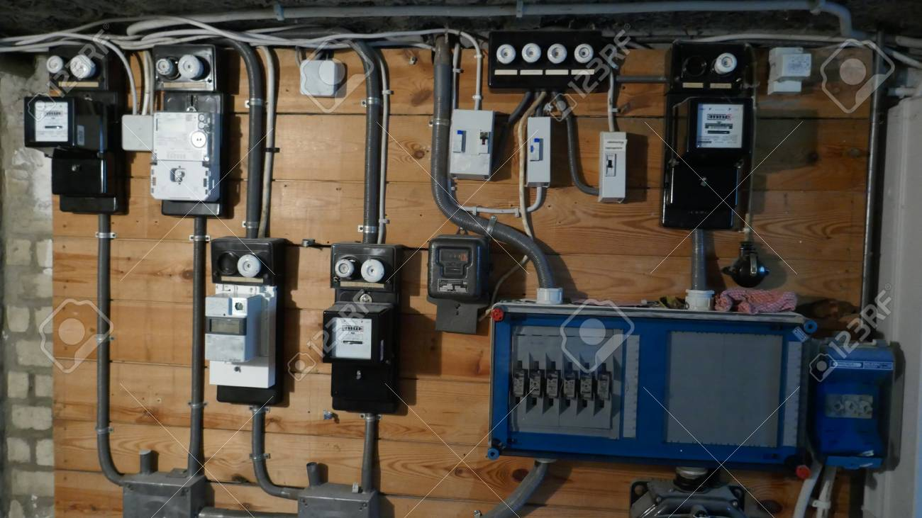 hight resolution of electrical fuse boxes and power lines in the basement of an old apartment building stock photo