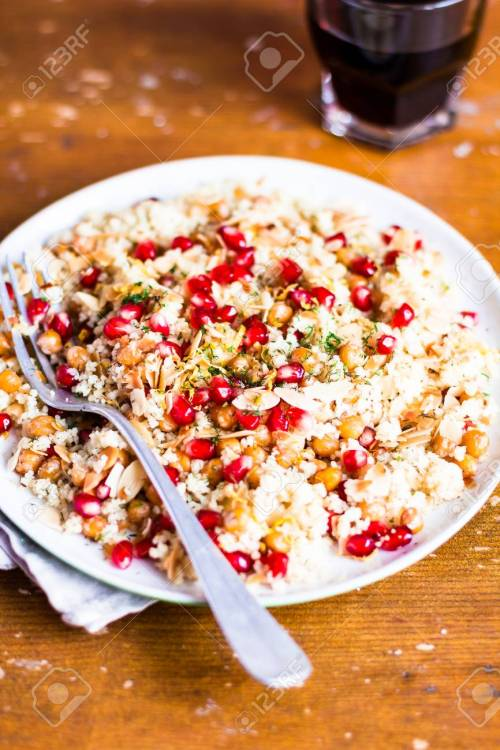 small resolution of stock photo traditional east asian meal plate of warm salad with couscous chickpea pomegranate seeds lemon zest almond flakes and dill on a wooden