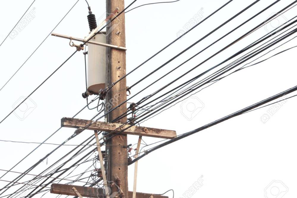 medium resolution of electric pole connect to the high voltage electric wires on blue sky background stock photo