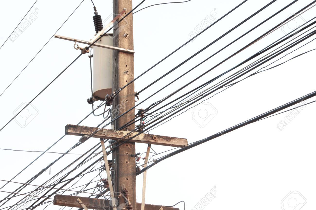hight resolution of electric pole connect to the high voltage electric wires on blue sky background stock photo