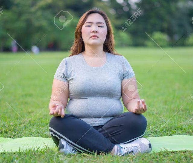 Beautiful Fat Woman Meditation In The Garden Stock Photo