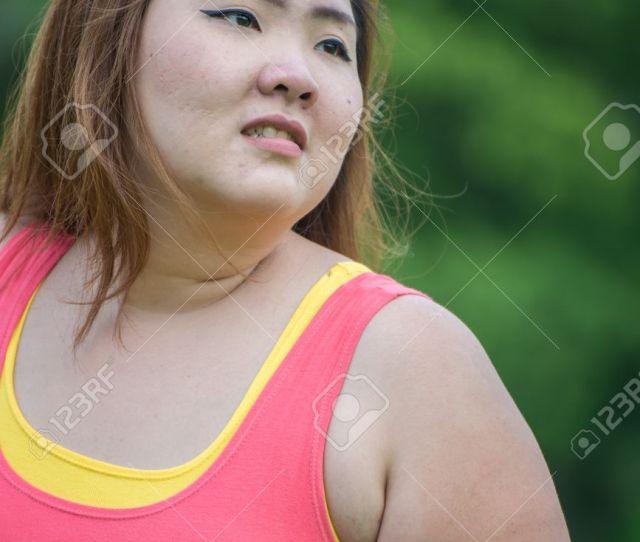 Happy Asian Fat Woman In Garden Stock Photo