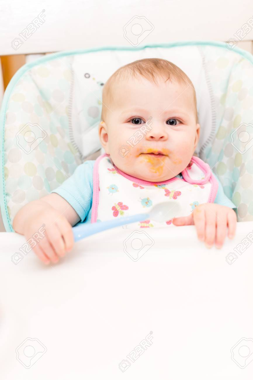 Baby Food Chair Little Girl Eating Baby Food In High Chair