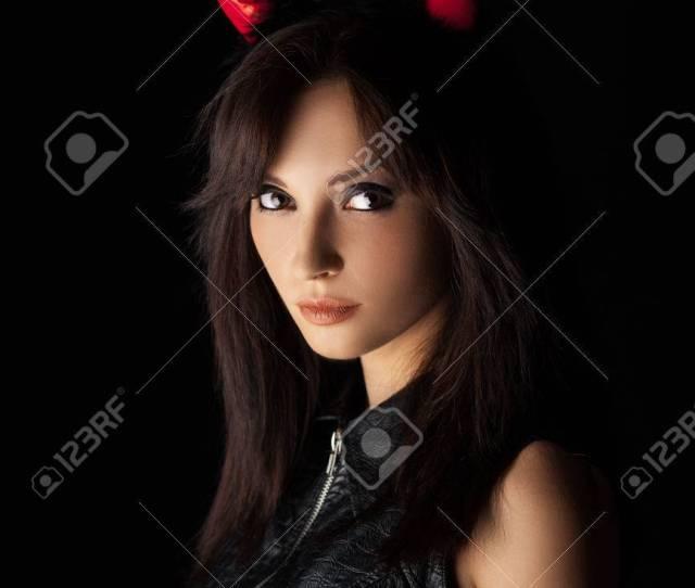Sexy Brunette Girl Wearing A Halloween Costume Of A Devil Beautiful Mixed Race Caucasian Asian