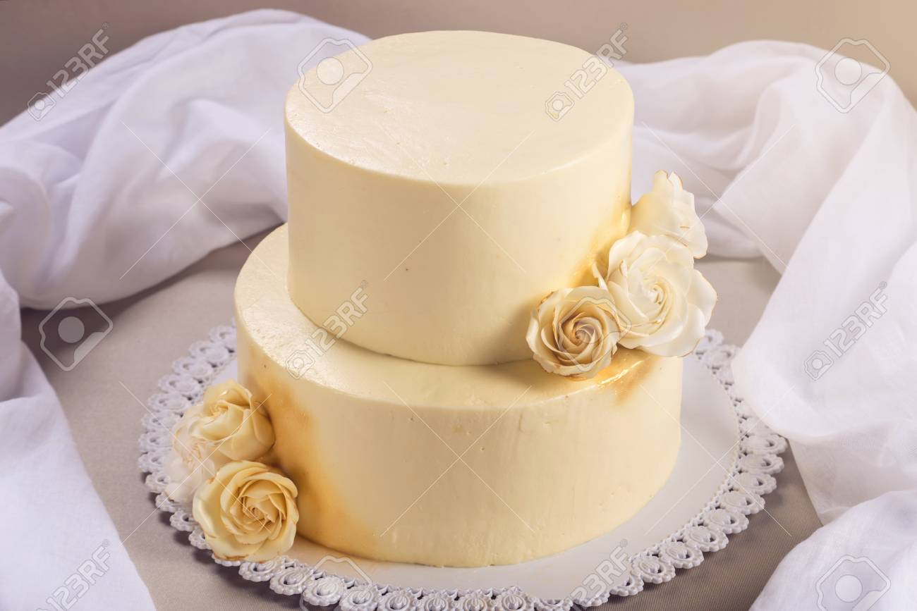 Beige 2 Tiered Wedding Cake Decorated With Mastic Roses Stands
