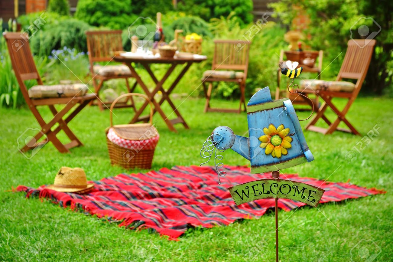 Picnic Chairs Close Up Of Sign Welcome And Red Picnic Blanket With Straw Hat