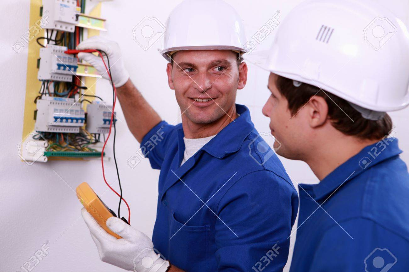 hight resolution of electrical safety inspectors verifying central fuse box stock photo 12006082