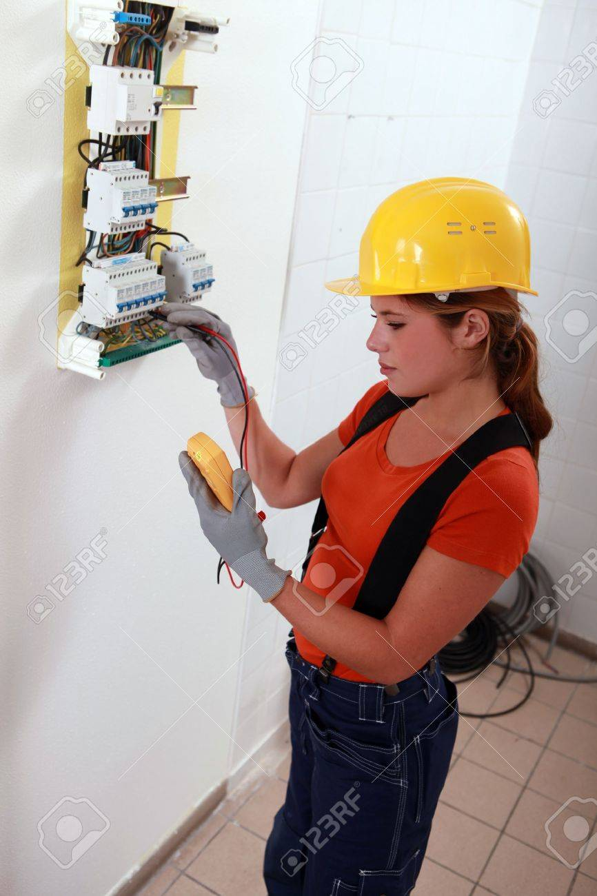 medium resolution of female electrician with a fuse box stock photo 13783093