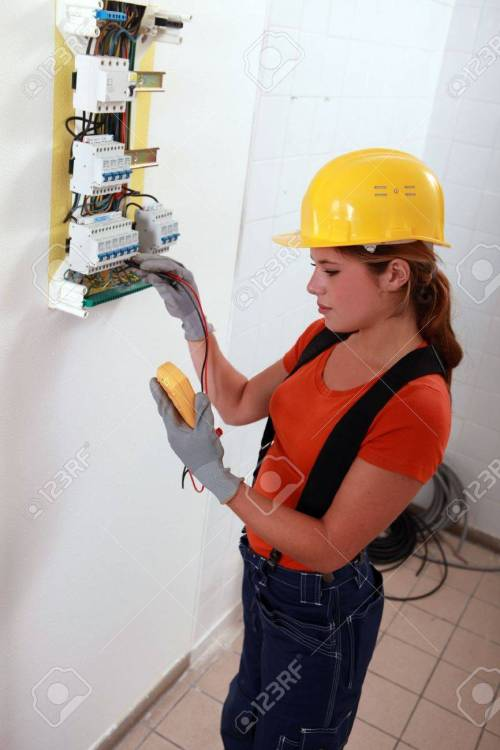 small resolution of female electrician with a fuse box stock photo 13783093