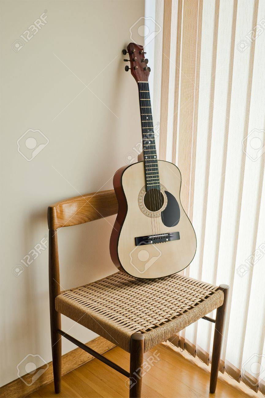 classical guitar chair for 1 year old on a modern stock photo picture and royalty 14713234