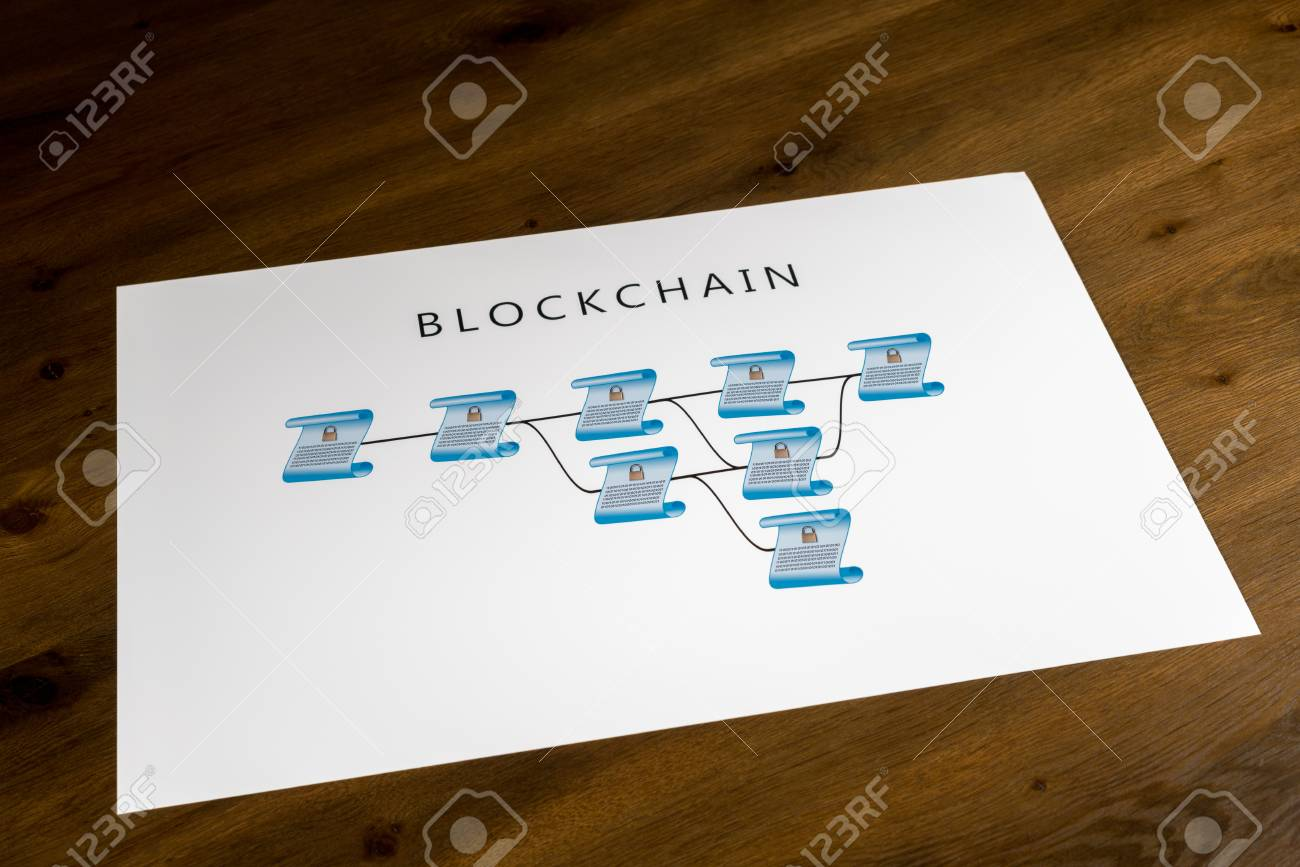 hight resolution of blockchain schematic on printout on desk or boardroom table showing encrypted blocks of ledger stock photo