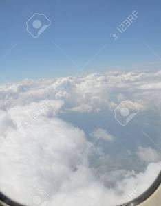 Plane window with blue sky and white clouds charter flight from poland to turkey also rh rf