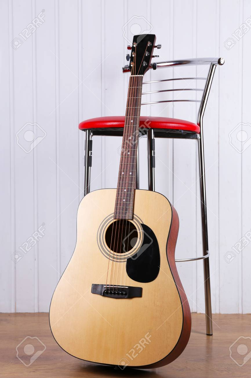 classical guitar chair chairs wedding hire near on white wooden wall background stock photo 93481145